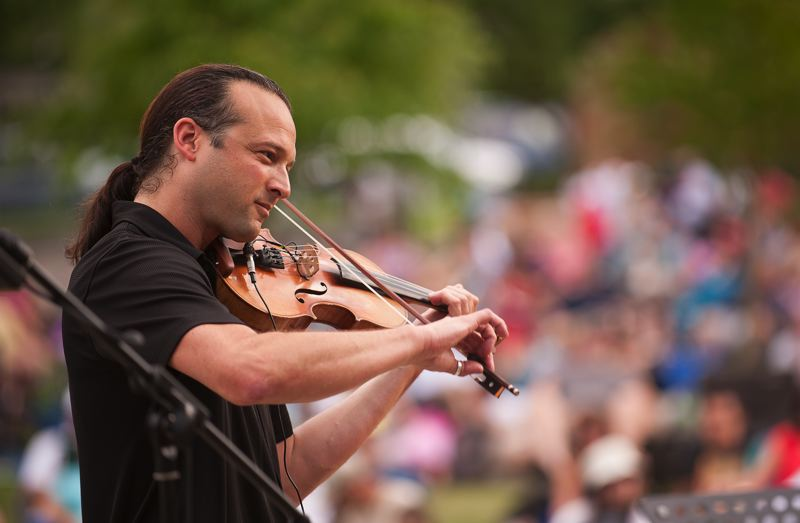 Photo Credit: SPOKESMAN PHOTO: JOSH KULLA - Aaron Meyer plays Kashmir by Led Zeppelin at Town Center Park.
