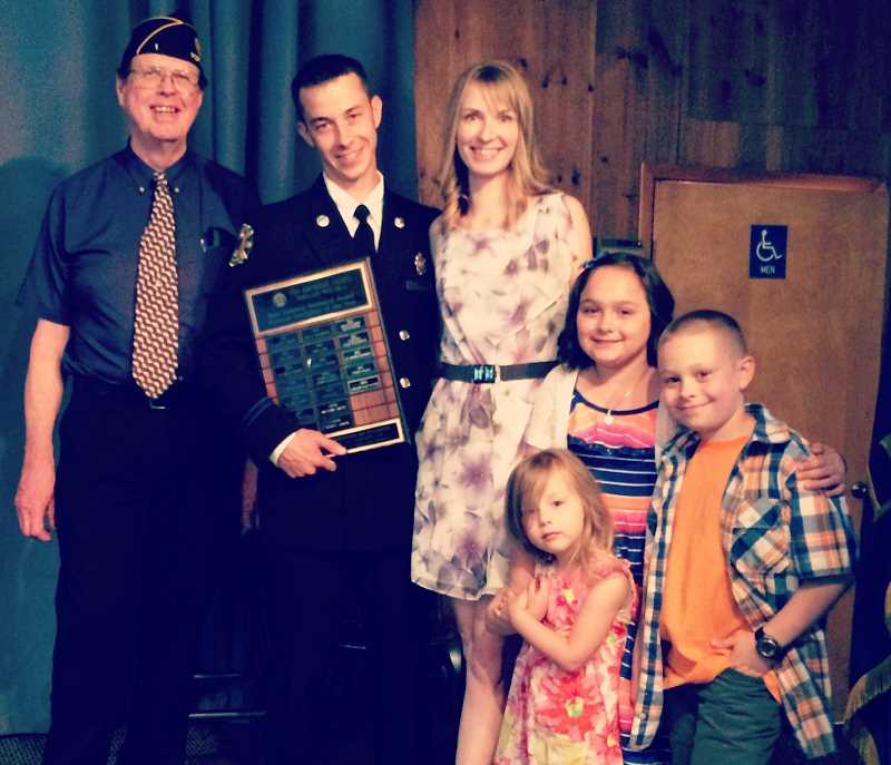Portland VFW Post Commander John Bolner (left) with Adam Salvetti, his wife Karen Salvetti and their children, Daisy, Mckenna and Maxam,      following the   presentation     ceremony naming Savetti Portland Firefighter of the Year 2014