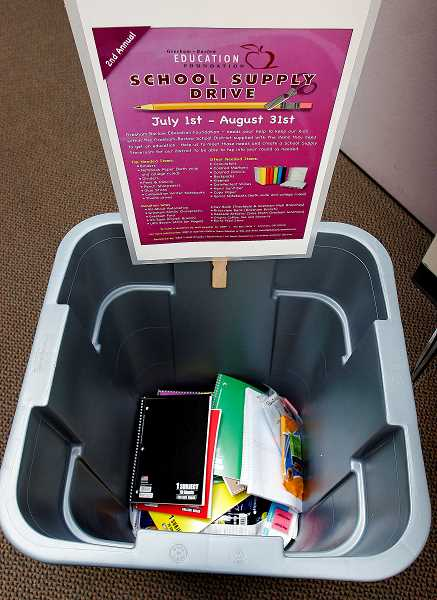 Photo Credit: OUTLOOK PHOTO: JIM CLARK  - Donation drop bins are located at several local businesses.