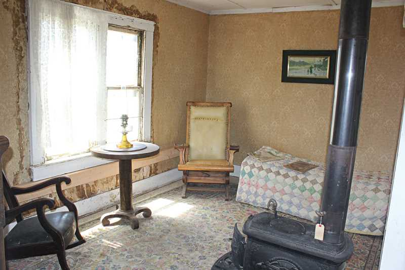 Photo Credit: SUSAN MATHENY/MADRAS PIONEER - The living room, or parlor, of the old two-story homestead.