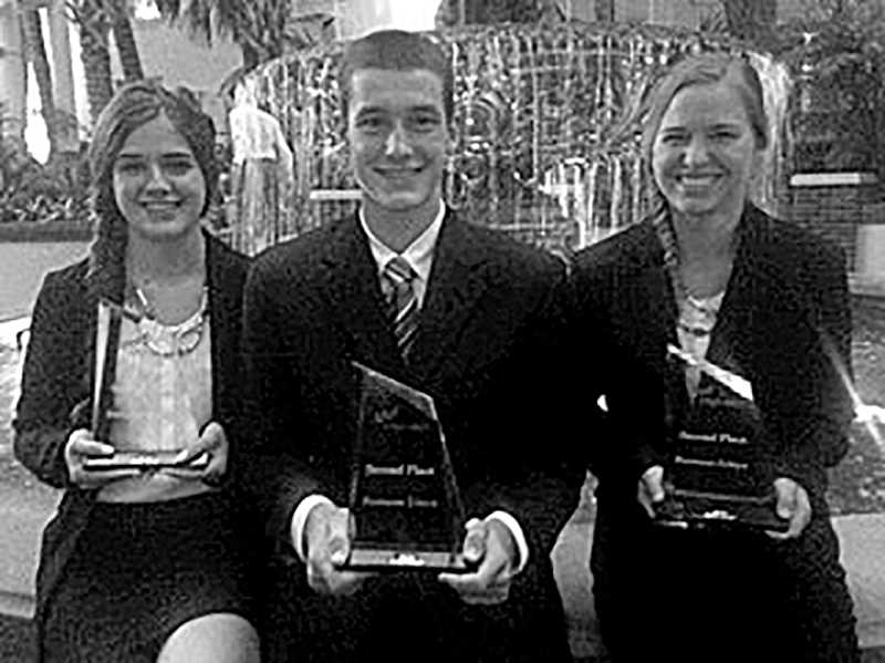 Photo Credit: SUBMITTED PHOTO - Canby's Ryan Bigej, Miranda Gibson and Natasha Troxler returned home from the FBLA National Leadership Conference with Awards of Excellence.