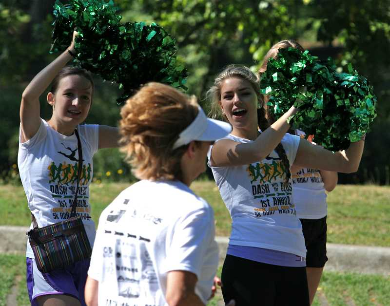 Photo Credit: TIDINGS FILE PHOTO - Members of the Debutantes dance team will again cheer runners and walkers on during the Dash With the Debs Aug. 16.