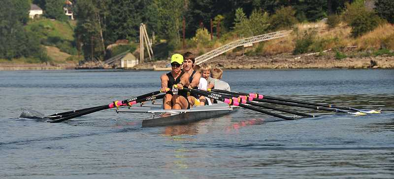 Photo Credit: TIDINGS PHOTO: VERN UYETAKE - Members of the rookie boys team work out on the Willamette  River August 4.
