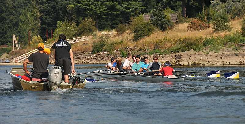 Photo Credit: TIDINGS PHOTO: VERN UYETAKE - Lake Oswego Community Rowing's rookie boys team take an eight-member team out on the Willamette River for a workout.