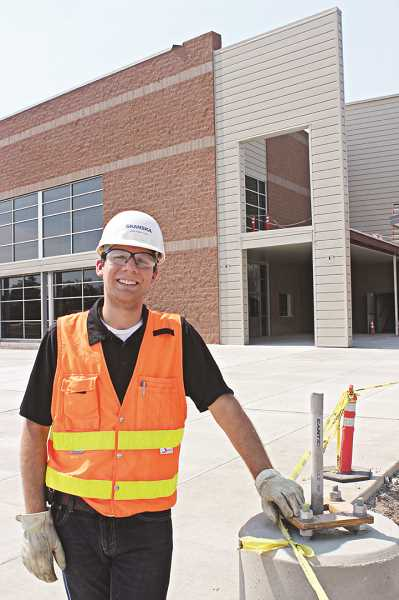 Photo Credit: HOLLY M. GILL - Hans Rindfleisch stands outside the public entrance to the Performing Arts Center.