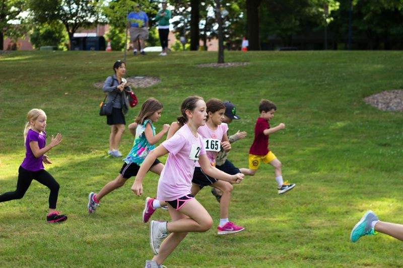 Photo Credit: TIMES PHOTO: LACEY JACOBY - Young racers get moving and compete in the Kids Dash during the second annual Sun Run in Beaverton.