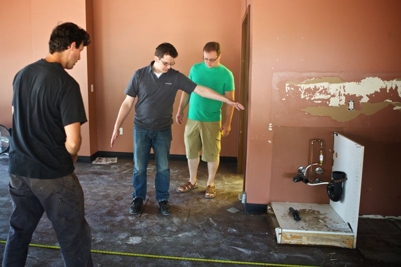 Photo Credit: TIMES PHOTO: JAIME VALDEZ - Bogza Coffee owner Tim Bogza shows contractor Matthew Peterson where he envisions a counter for his coffee business at The Round.