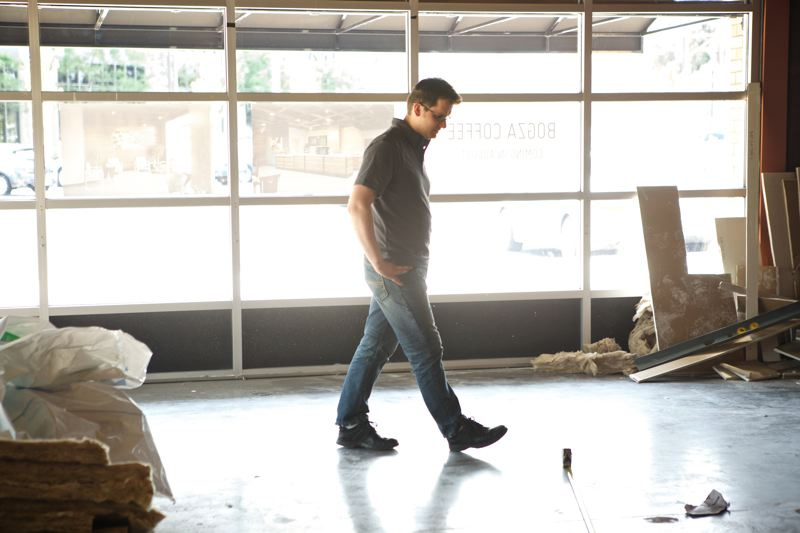 Photo Credit: TIMES PHOTO: JAIME VALDEZ - Tim Bogza, a design firm owner, checks on the construction of his coffee business, Bogza Coffee, at The Round, which opens later this month.