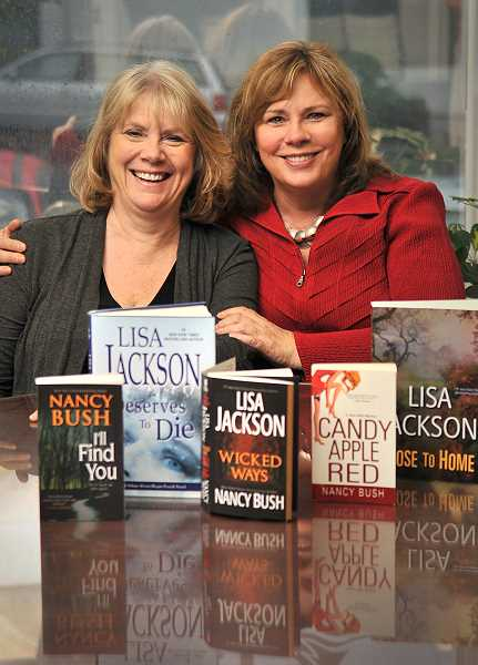 Photo Credit: STAFF PHOTO: VERN UYETAKE - Lake Oswego best-selling authors Nancy Bush, left, and Lisa Jackson, pose with a few of their newly released books.