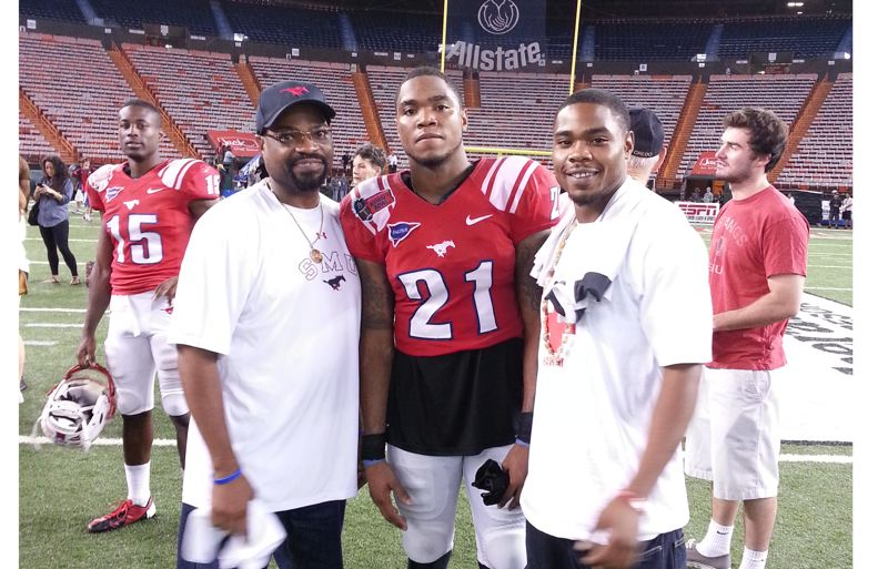 Photo Credit: COURTESY OF TINA ACKER - Cornerback Kenneth Acker (middle) celebrates his Southern Methodist football career after a game with his father, Karl Sr. (left), and older brother, Karl Jr.