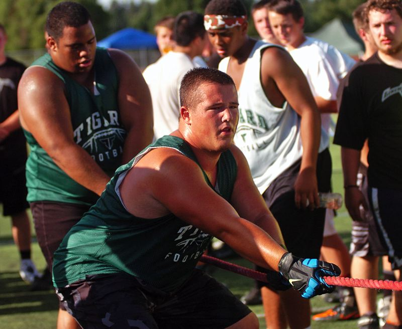 Photo Credit: DAN BROOD - POWER -- Tigard's Conner Crist gives it his all during the tug-of-war competition.