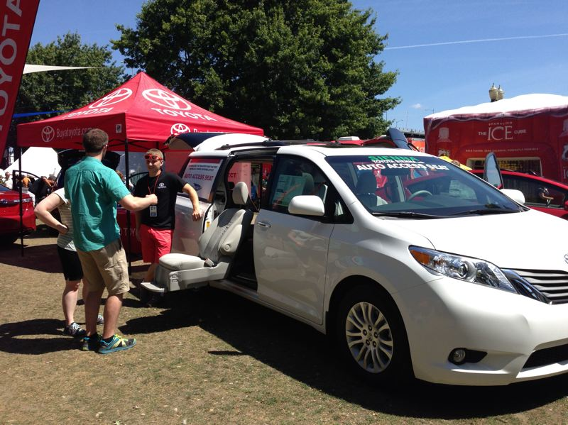 Photo Credit: PORTLAND METRO TOYOTA DEALERS ASSOCIATION - Bite of Oregon visitors check out the Toyota Sienna Mobility, which includes an auto access seat for passengers with disabilities.