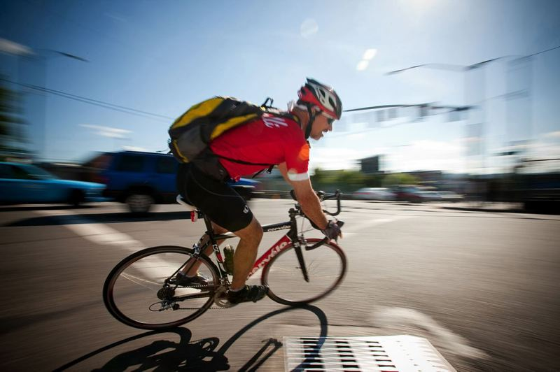 Photo Credit: TRIBUNE FILE PHOTO: CHRISTOPHER ONSTOTT - A cyclist makes the turn from Northeast Broadway onto North Williams Avenue where a bike specific signal alerts riders when it is safe to cross traffic. Portland officials plan a street improvement project to avoid problems for bicycle traffic on the busy street.