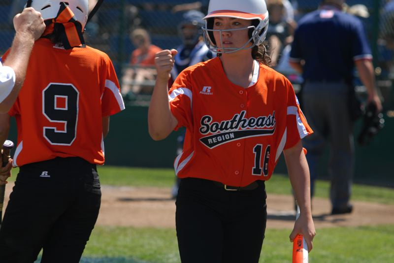 Photo Credit: PORTLAND TRIBUNE: DAVID BALL - Kamdyn Fuller returns to the Columbus dugout after scoring the only run of the game in the third inning Saturday. She knocked a triple into center field to set up the chance.