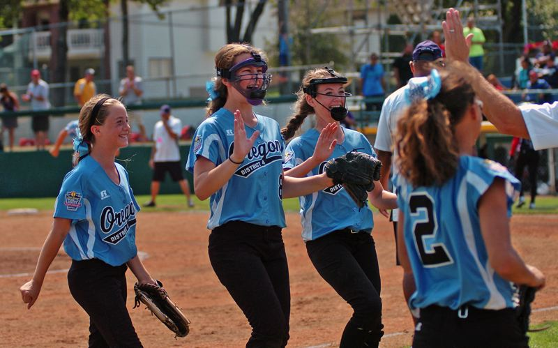 Photo Credit: DAN BROOD - WINNING SMILES -- Tigard/TC's (from left) Bella Valdes, Brooke Clinton and Elizabeth Hillier are all smiles following the team's 2-1 victory over Puerto Rico Sunday at the Little League Softball World Series.