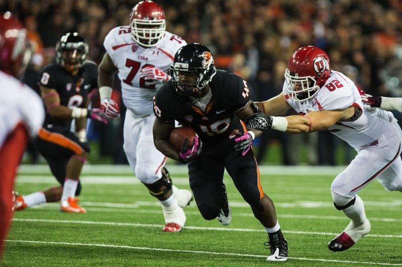 Photo Credit: TRIBUNE FILE PHOTO: CHRISTOPHER ONSTOTT - Michael Doctor, returning an interception against Utah, is a key veteran outside linebacker for the Oregon State Beavers.