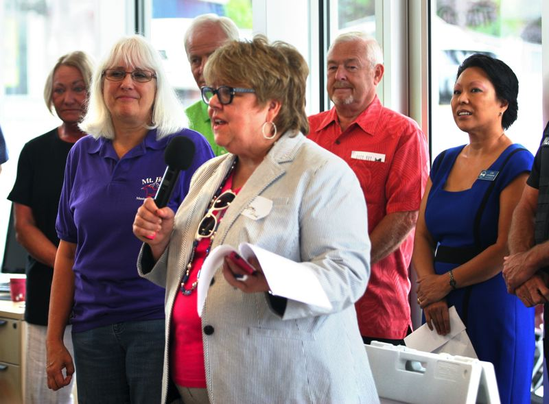 Photo Credit: OUTLOOK PHOTO: JIM CLARK - Gresham Ford General Manager Bess Wills addressed members of the Gresham Area Chamber of Commerce and Visitors Center shortly before an official ribbon cutting at the dealership Friday, Aug. 8.