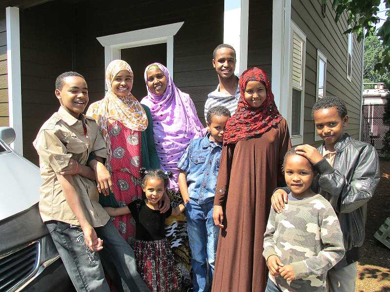 Photo Credit: OUTLOOK PHOTO: LAURA KNUDSON - After waiting seven years to come to America, Sahra Mohamed arrived in 2012 with her eight children. Faced with new challenges in the United States, Mohameds family is one of hundreds seeking help from the African Youth and Community Organization (AYCO).
