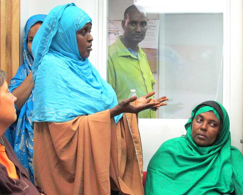 Photo Credit: OUTLOOK PHOTO: LAURA KNUDSON - Isnina Abdullahi speaks of challenges refugee children face in education during the opening of AYCOs new office.