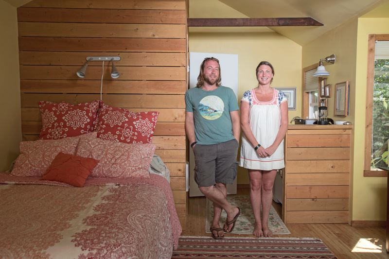 Photo Credit: TRIBUNE PHOTO: JONATHAN HOUSE - American Gothic 2.0: Rachel Robinson and Joe Culhane can afford to work as atists by letting out their backyard studio in Concordia on Airbnb, and occasionally, their whole house. Its changing the landscape of our lives: what is work, what is acceptable socially and in our neighborhood, says Culhane.