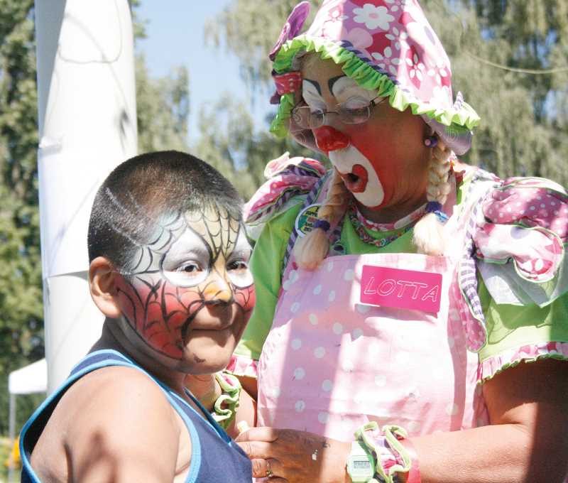Photo Credit: PHIL HAWKINS - Lotta the Clown made a repeat appearance at the event to paint the faces of dozens of children.