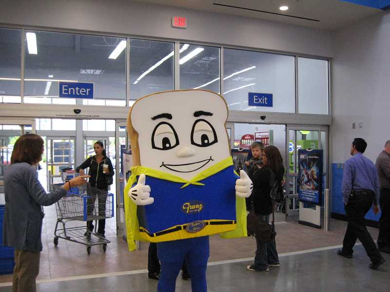 Photo Credit: GAZETTE PHOTO: RAY PITZ - And what grand opening would be complete without the Franz Bread mascot who gave a thumbs up as he entered the new Walmart store Wednesday.