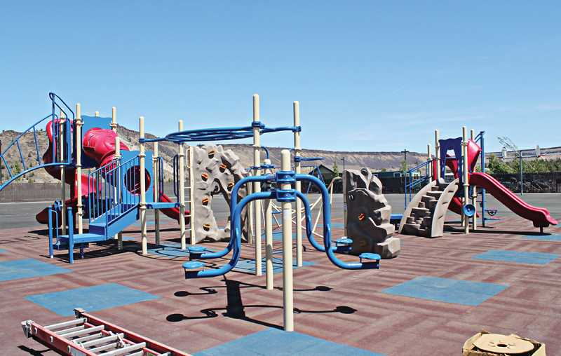 Photo Credit: HOLLY M. GILL - The new playground equipment at Warm Springs K-8 Academy, located on the east side of the school, has rubberized mats underneath, and beautiful views of the surrounding mesas above.