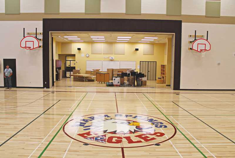Photo Credit: HOLLY M. GILL - The new gymnasium features a logo of the school's mascot - an eagle. The gym is set up so that an automated divider can descend from the ceiling to separate the large gym into two smaller gyms.