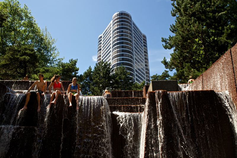 Photo Credit: TRIBUNE PHOTO: JAIME VALDEZ - Despite Park Bureau warnings, a few Portlanders are taking advantage of Keller Fountain's cool water on hot summer days. In years past, large crowds often flocked to the fountain and park experts say those crowds helped keep the park safer.
