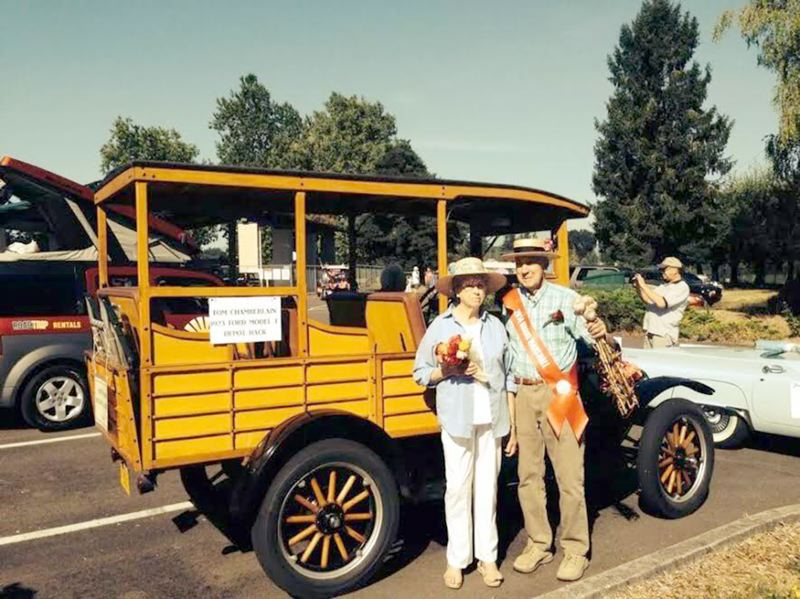 Photo Credit: COURTESY PHOTO - Mary Ellen and Melvin Van Domelen are all smiles as they pose beside their antique car before the Garlic Festival parade.