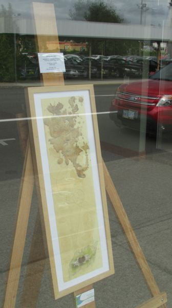 Photo Credit: MARK MILLER - A piece by Scappoose artist Jennifer Bolhofner, entitled 'Barriers of Enderism,' sits in the window of a vacant storefront on Columbia Boulevard. Bolhofner's artwork, which she said is inspired by the two years she spent in the Pacific island territory of Guam, is on display as part of a St. Helens Economic Development Corp. effort to repurpose empty storefronts in St. Helens as sidewalk art galleries.
