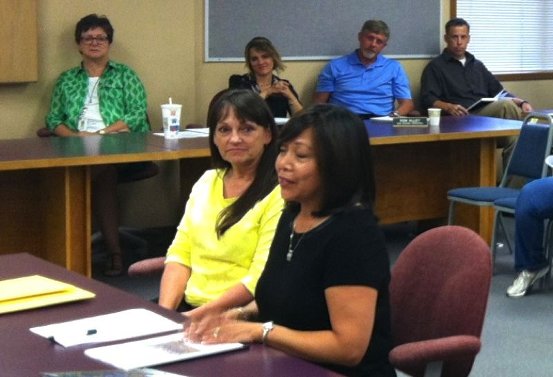 Photo Credit: MARK MILLER - Anita Ott-Veile (right foreground), outgoing principal of South Columbia Family School, speaks as the Scappoose School District's new principals look on at a Monday, Aug. 11, school board meeting. Left of Ott-Veile is her successor at the Family School, Lori Bogen. In background, from left to right: Warren Elementary School Principal Laura LaMarsh, Otto Petersen Elementary School Principal Whitney Hessong, Scappoose Middle School Principal Ron Alley and Scappoose High School Principal Andy DeBois.