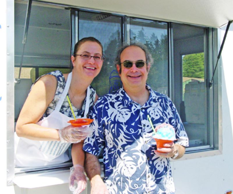 Photo Credit: PHOTO COURTESY OF NATURALSHAVEICE.COM - Cheryl C. and John Alland, co-owners of Island Daydreams Shave Ice LLC.