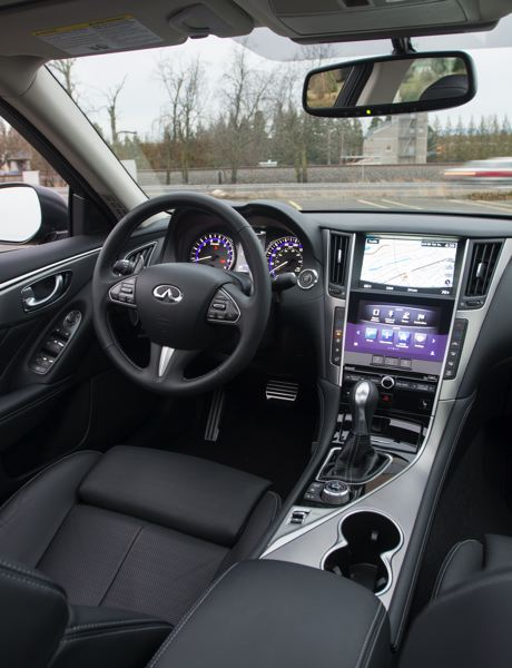 Photo Credit: JOHN M. VINCENT - The 2014 Infiniti Q50S features a cockpit-like cabin and two large information screens.