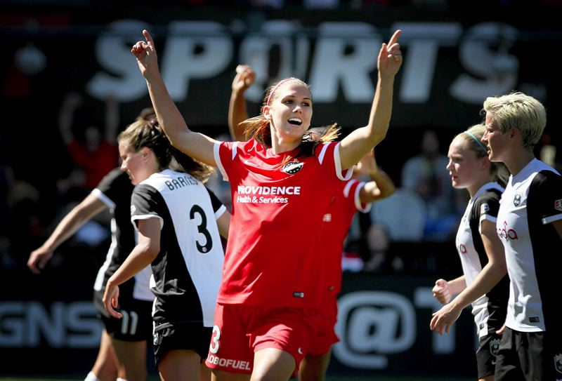 Photo Credit: TRIBUNE PHOTO: JONATHAN HOUSE - Forward Alex Morgan celebrates her winning goal in Sunday's 1-0 victory over the Seattle Reign.