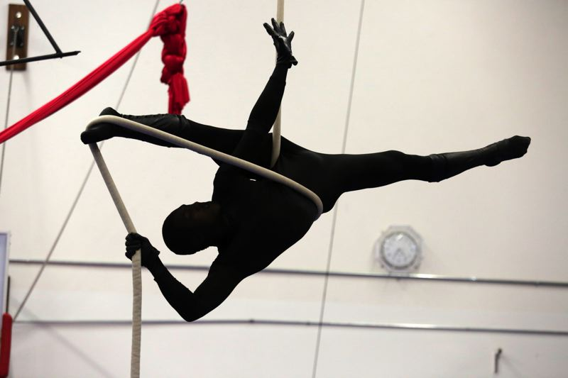 Photo Credit: TIMES PHOTO: JONATHAN HOUSE - MoNika Ell wears an all-black suit during practice for Pendulum Aerial Arts' production of 'High Art.'