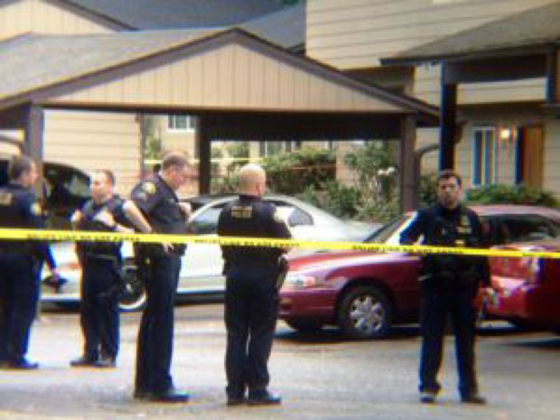 Photo Credit: KOIN 6 NEWS - Police secure the scene of the fatal shooting in east Portland.