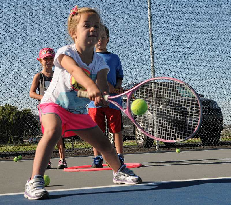 Photo Credit: LON AUSTIN/CENTRAL OREGONIAN - Mckinley Sloper works on her backhand during the Crook County Parks and Recreation tennis camp. The annual camp runs through next week.