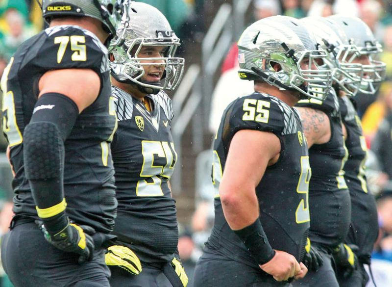 Photo Credit: COURTESY OF GEOFF THURNER - Center Hroniss Grasu (second from left) eschewed early entry into the NFL draft and returned to the Oregon Ducks with the likes of quarterback Marcus Mariota and cornerback Ifo Ekpre-Olomu.