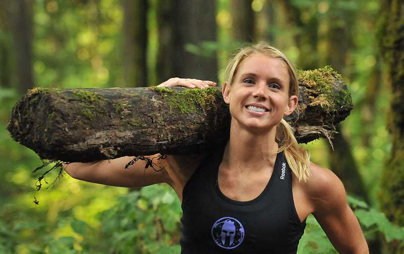 Photo Credit: REVIEW, TIDINGS PHOTO: VERN UYETAKE - Amelia Boone comes under some crushing burdens as a obstacle race competitor. But she can smile because she is the world champion in this rising sport.