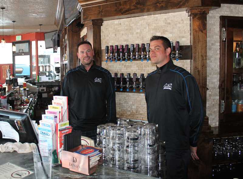 Photo Credit: JIM BESEDA/MOLALLA PIONEER - Ben Rash (left) and Ryan Gengler standing behind the bar at The Gallon House in Silverton -- their hometown.