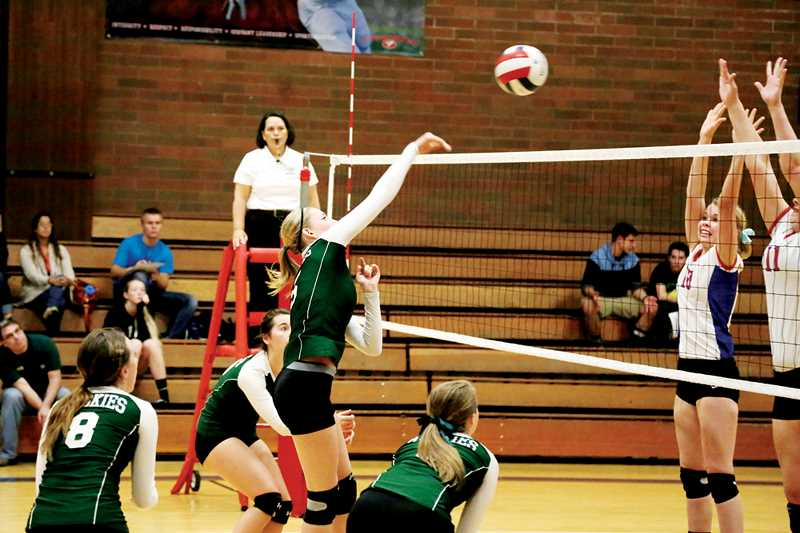 Photo Credit: JO WHEAT - North Marions Karly Griffin (at the net) is one of a five juniors who are expected to return to the Huskies this fall as the team transitions to a new coach and new conference.