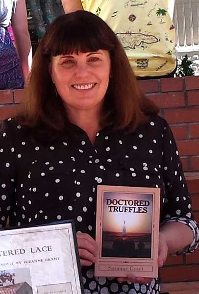 Photo Credit: SUBMITTED - Suzanne Grant stands with her third novel, 'Doctored Truffles.'