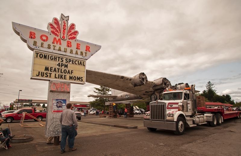 Photo Credit: SPOKESMAN PHOTO: JOSH KULLA - The Bomber restaurant in Milwaukie draws its name from the Lacey Lady, a B-17G that has lived at this spot along busy Highway 99 since 1947. Now, the plane is going to Aurora State Airport, where it will undergo restoration.