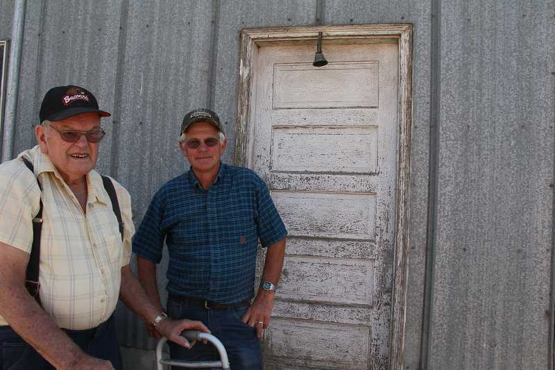 Photo Credit: NEWS-TIMES PHOTO: STEPHANIE HAUGEN - Wilbur Pete Jansen (left) still consults with his oldest son, Mike, who took over the dairy.