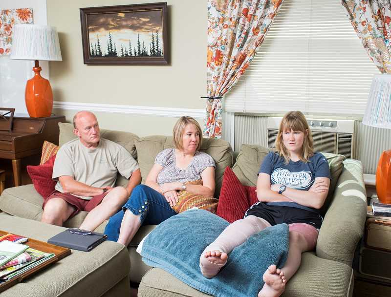 Photo Credit: NEWS-TIMES PHOTO: CHASE ALLGOOD - Recalling the ups and downs of life in the hospital, Kylie Marble talks with her parents, Charlie and Anita, at home in Forest Grove. An operation to harvest skin from Kylies unwrapped leg for grafting onto her damaged leg caused the redness shown in the photo.