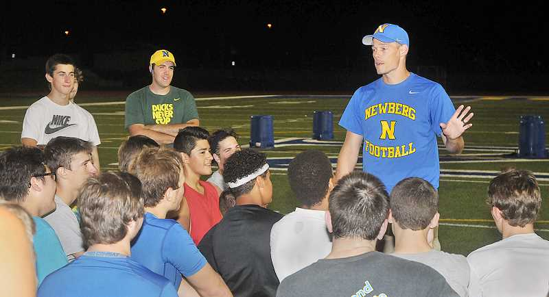Photo Credit: SETH GORDON - Getting started - Head coach T.J. Tomlin instructs attendees at the annual NHS preseason football camp last week at Loran Douglas Field.
