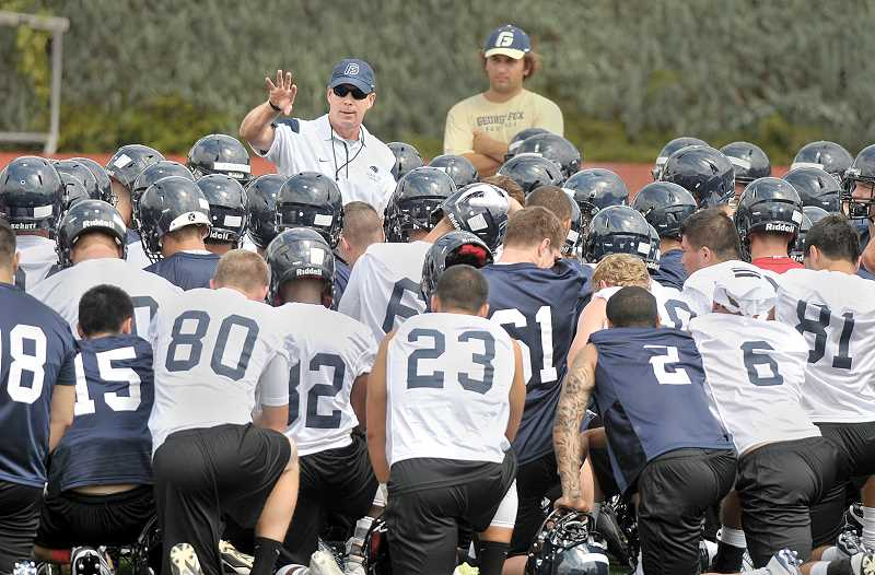 Photo Credit: GARY ALLEN - Leader - Head coach Chris Casey fires up his players during a brief huddle before Thursday's practice at Stoffer Family Stadium. The Bruins continue practices this week in anticipation of their Sept. 6 opening game.