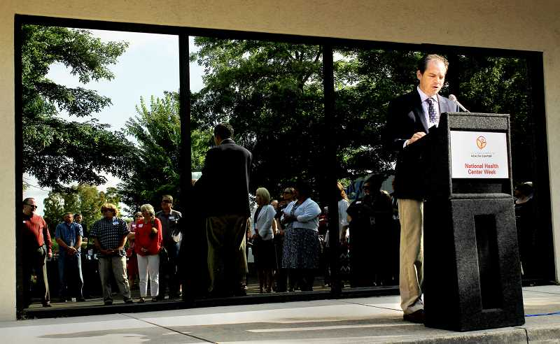 Photo Credit: NICO HAMACHER - Affordable healthcare - Virginia Garcia CEO Gil Muñoz spoke at the grand opening for the Newberg  clinic Aug. 14. The health clinic will serve about 2,400 low-income patients a year.