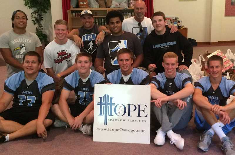 Photo Credit: SUBMITTED PHOTO: KEITH DICKERSON - Members of the Lakeridge football team collected food for Hope Sparrow Services. The volunteers were, from left, top row: Malik Newton, Austin Peters, Coach Chad Carlson, Massen Newton, Head Coach John Parke and Ben Thrasher; bottom Row: Michael Kiever, Spencer Gregg, Michael Kuhn, Keaton Wood and D.J. Dalzell.